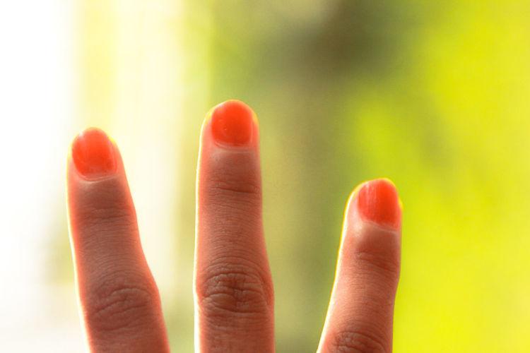 Close-up of human hand with nail varnish
