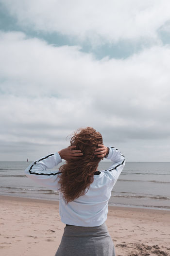 The Week on EyeEm Beach Beauty In Nature Casual Clothing Cloud - Sky Hair Hairstyle Horizon Horizon Over Water Land Leisure Activity Lifestyles Looking At View Nature One Person Outdoors Real People Sea Sky Standing Water Women The Traveler - 2018 EyeEm Awards The Portraitist - 2018 EyeEm Awards
