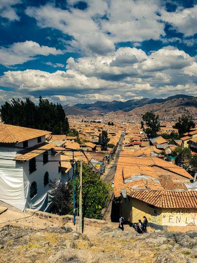 Cusco orange Cusco Peru Nature TOWNSCAPE Landscape Cityscape Sunny Sunny Day Noon Sunbath Road Highway Water Beach Sky Cloud - Sky Residential District Residential Structure Residential Building Building Town Tranquil Scene Scenics Human Settlement Skyline