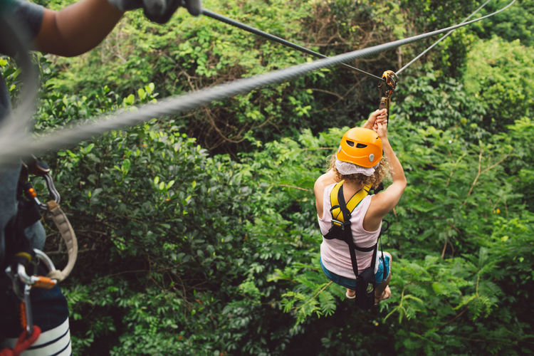 Thailand Curly Hair Girl Rope Adventure Holding Leisure Activity Fun Plant Headwear Safety Nature Safety Harness Protection Tree Helmet Males  Real People Men Day Outdoors Sport Forest Hand