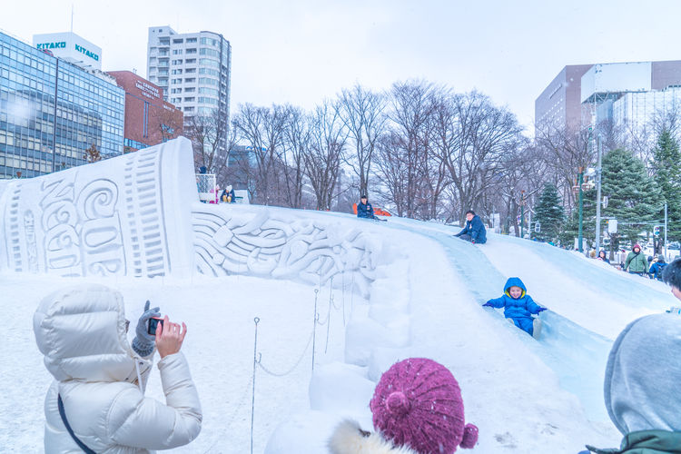 Sapporo Snow Festival Feb 2018 Japan Japan Photography Japanese  Sapporo,Hokkaido,Japan Snow ❄ Architecture Bare Tree Building Building Exterior Built Structure City Cold Temperature Day Leisure Activity Lifestyles Nature Outdoors People Plant Real People Sapporo Snow Snow Covered Snowing Technology Tree Warm Clothing Winter