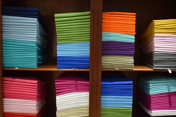 Colorful fabrics arranged on shelves