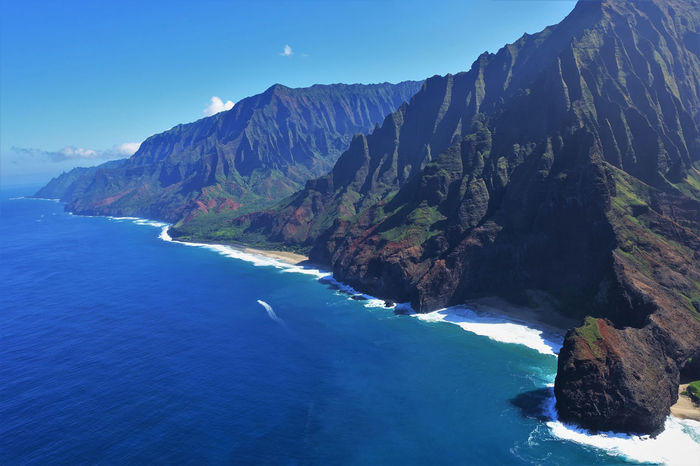 Breathtaking Hawaii Holiday Holidays Kauai Na Pali Coast Panorama Tropical Paradise Vacations Beauty In Nature Blue Break The Mold Breathtaking Sceneries Cliff Helicopter View  Kauai Hawaii Landscape Mountain Nature Outdoors Panoramic Landscape Sea Sky Tropical Water