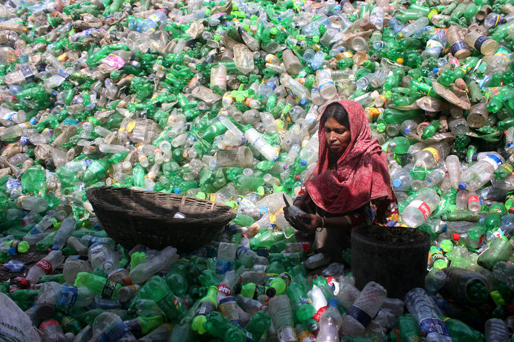 Portrait of smiling woman working with plastic