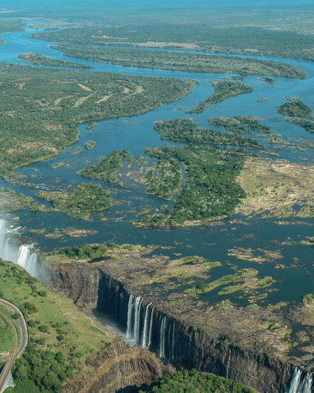 Zambezi River and Victoria Falls from the air, Zimbabwe Mosi-oa-tunya Travel Photography Travel Destinations Park Travel River Victoria Falls Zimbabwe Zambezi River Safari Water Rural Scene Aerial View Landscape Green Color Flowing Water Lush - Description Stream - Flowing Water Waterfall Falling Water Rapid