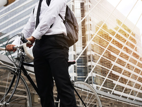 Business man riding bicycle go to worker. Activity Architecture Bicycle Building Exterior Built Structure Business Person City Clothing Day Land Vehicle Lifestyles Men Mode Of Transportation Motion on the move One Person Outdoors Real People Riding Transportation Walking