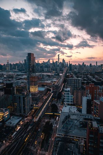 High angle view of city street against sky during sunset