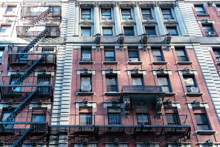Old apartment building in NYC City Cityscape Fire Escape New York New York City New York Skyline  USA America Apartment Architecture Backgrounds Building Building Exterior Built Structure City Day Fire Escape Full Frame Glass - Material In A Row Low Angle View No People Old Outdoors Railing Residential District Side By Side Staircase Window