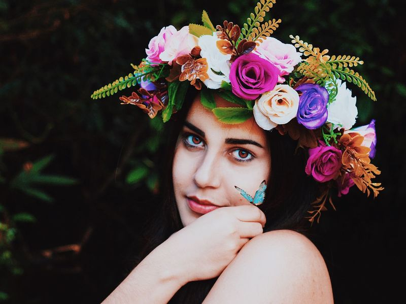 Flower One Person Beautiful Woman Headshot Looking At Camera Beauty Real People Portrait Laurel Wreath Close-up Multi Colored Headdress Young Adult Human Body Part One Woman Only Outdoors Day Adult One Young Woman Only Adults Only