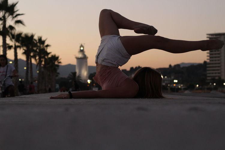 Full length of teenage girl ballet dancing on footpath in city