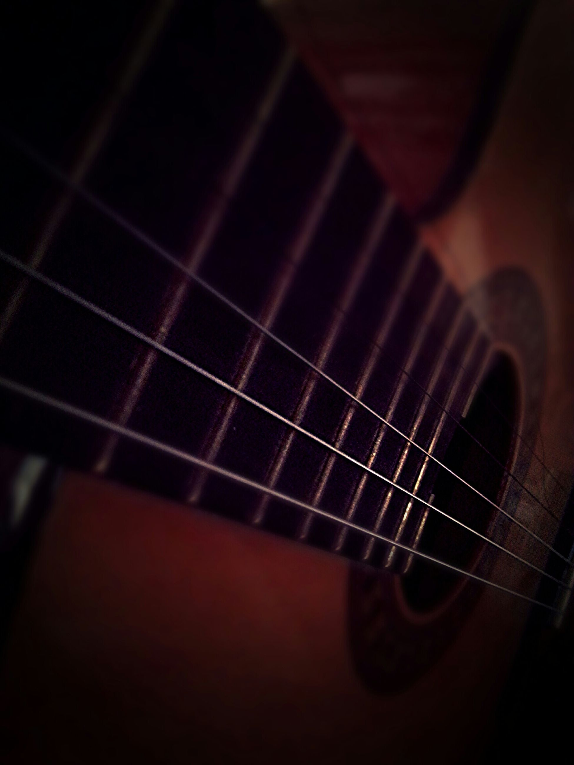 indoors, music, musical instrument, musical instrument string, arts culture and entertainment, guitar, musical equipment, close-up, selective focus, string instrument, acoustic guitar, technology, part of, metal, no people, illuminated, high angle view, cropped, single object, connection