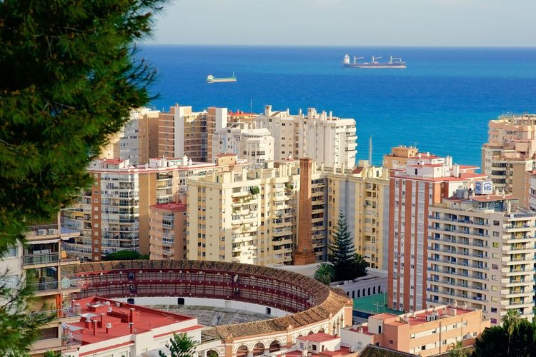 Malaga. Architecture Bull Ring City Cityscape Day Málaga,España No People Outdoors Sea SPAIN Spain ✈️🇪🇸 Sunlight Water The Graphic City Housing Settlement TOWNSCAPE Skyscraper Urban Skyline Boat Residential Structure