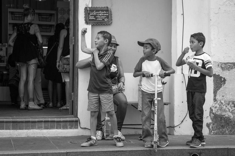 Adult Black Black And White Blackandwhite Blackandwhite Photography Boys Casual Clothing Day Full Length Ice Cream Kids Kids Being Kids Leisure Activity Lifestyles Muscles People Puerto Rico Real People Scooter Street Street Photography Streetphoto_bw Streetphotography Young Adult
