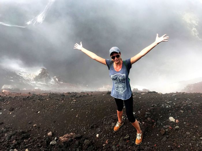 Arms Outstretched Arms Raised One Person Adventure Young Women Motion Fog Scenics Power In Nature Nicaragua Cerro Negro Volcanic Crater Volcanic Landscape Volcanic Rock Lava Field Lava Rock Adrenaline Junkie Determination Energetic Foggy Morning Foggy Landscape Women Long Exposure Hiking Nature