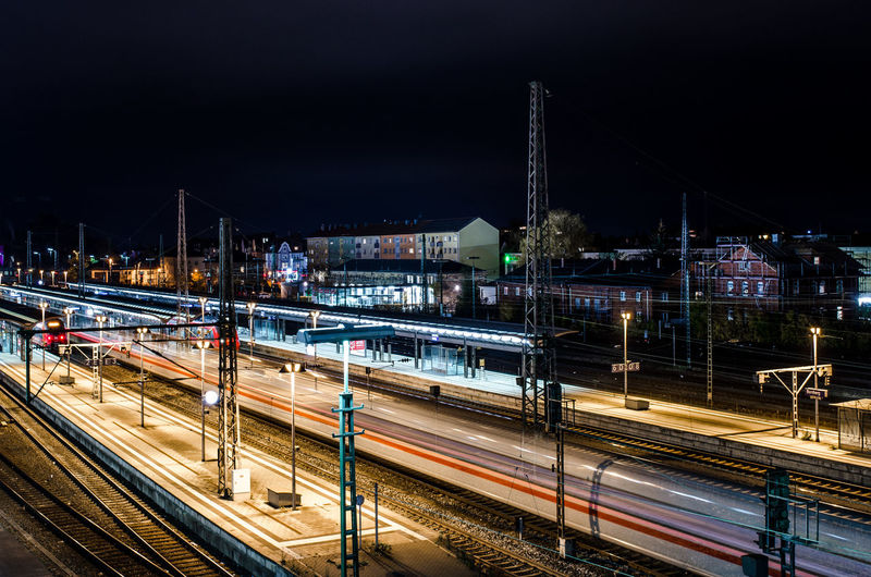 Transportation Architecture Night Illuminated Built Structure Long Exposure Motion City Building Exterior Light Trail Rail Transportation Train - Vehicle Train Railroad Track Mode Of Transportation High Angle View Speed Track Connection Public Transportation Bridge - Man Made Structure No People Outdoors Shunting Yard
