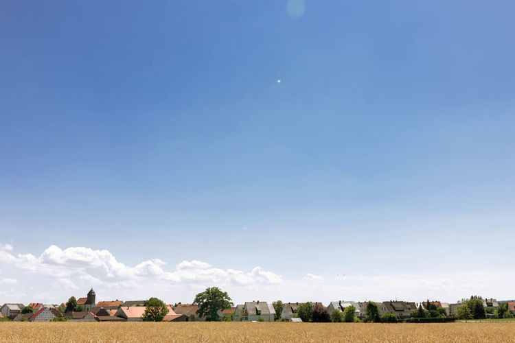 scenic view of agricultural field against sky Agriculture Beauty In Nature Blue Copy Space Day Environment Farm Feld Field Growth Juli Land Landscape Nature No People Outdoors Plant Rural Scene Scenics - Nature Sky Solitärbäume Tranquil Scene Tranquility Tree