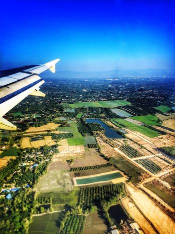 small farming Agriculture Orchard Paddy Field From An Airplane Window Bird Eyes View Landscape Land Used Blue Sky