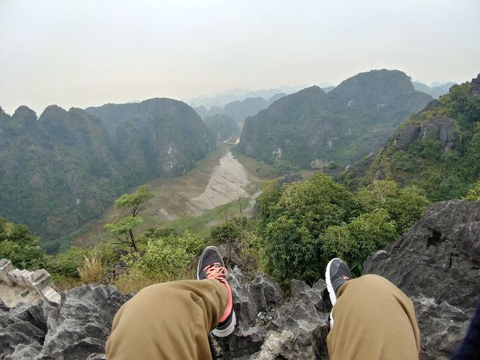 Taking the beauty of Ninh Binh in. Feet Feet Dangling Vietnam Ninh Bình River Go Higher Mountain Human Leg Personal Perspective High Angle View Hiker Mountain Range Valley