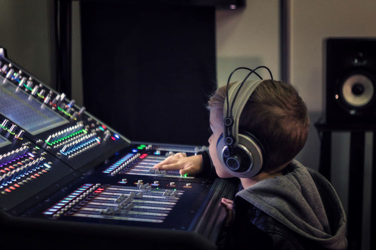 Headphones Audio Audio Equipment AudioEngineer Dj Editing Learning Music Sound Sound Mixing Switch Adjusting Boy Broadcasting Child Childhood Control Panel Kid Mixing Console Music Studio  Producer Radio Station Recording Studio Sound Mixer Technology Volume Club Dj Radio DJ Sound Recording Equipment Knob