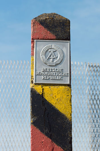 Border Change Communication Communist Day DDR East Germany Emblem  Fence GDR Germany No People Outdoors Prison Sky Text The Wall Wall Wende