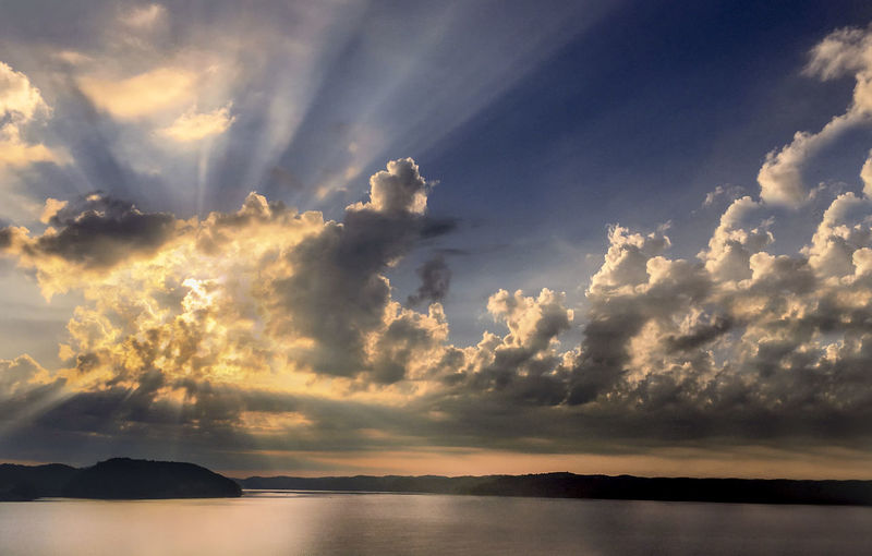 Beauty In Nature Cloud - Sky Dramatic Sky Horizon Idyllic Nature No People Outdoors Reflection Scenics - Nature Sea Sky Sunbeam Sunlight Sunset Tranquil Scene Tranquility Water Waterfront