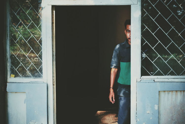 Framing EyeEm Best Shots EyeEm Selects EyeEm Gallery Light And Shadow Cinematic Cinema Look Cinema Mood Potrait Looking At Camera Illustration Fine Art Photography Men Standing Doorway Door Casual Clothing Sliding Door Entryway Closed Door Door Handle Front Door Open Door Entry