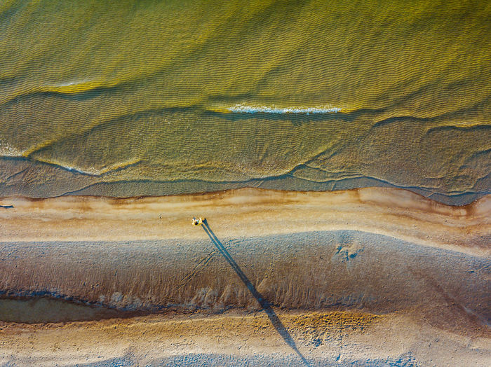 Alone in the beach Aerial Shot Baltic Sea Drone  Lietuva Man Backgrounds Beauty In Nature Drone Selfie Landscape Mavic Mavic Pro Nature No People Outdoors Pattern People Sand Scenics Sea Selfie Top Down View Tranquility Lost In The Landscape