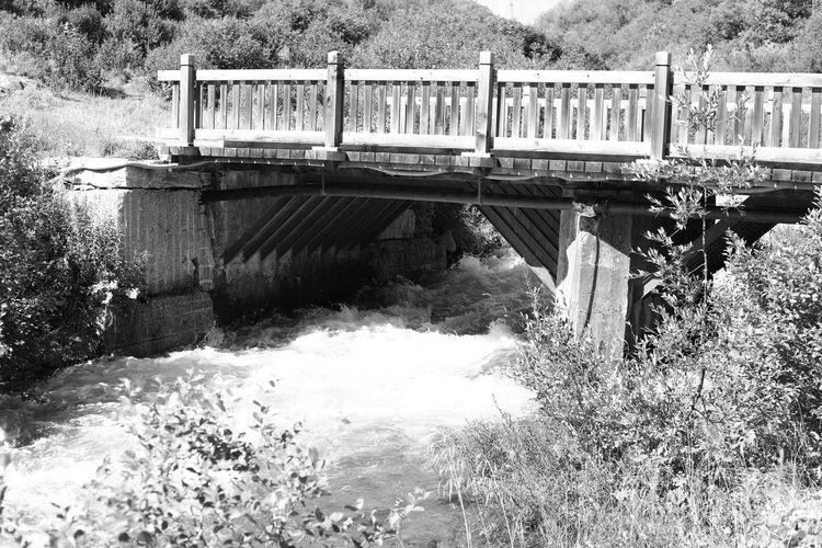 Bridge over river against blue wall