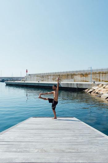 Full length of woman on pier against sky