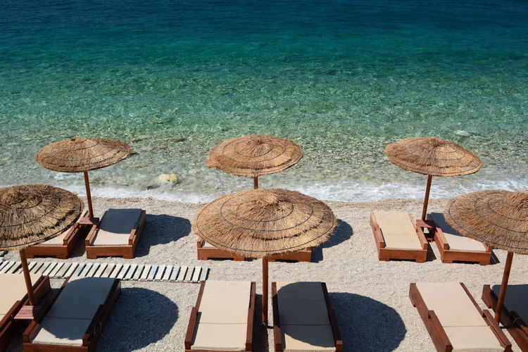 High angle view of parasols on table by sea