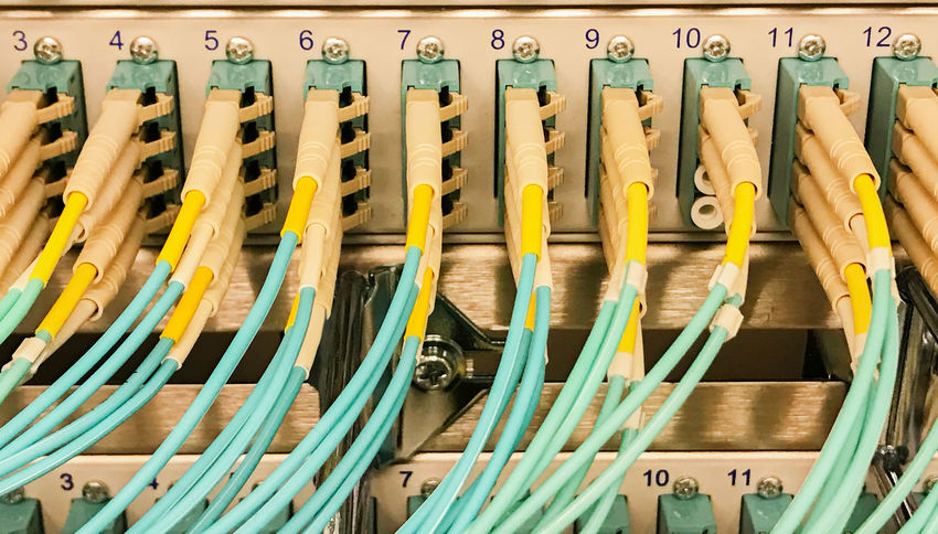 Network cable on a network HUB and Fiber optic light waveguide on a switch Data Store Patch Cable RJ45 Switch Cable Cable Connection Cat5 Cat6 Computer Computer Cable Concept Connection Cyberspace Data Security Ethernet Fiber Optic Cable Firewall Hub Lwl Network Network Cable Network Connection Patch Field Range Server