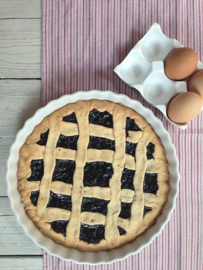 High Angle View Of Sweet Pie And Eggs On Table