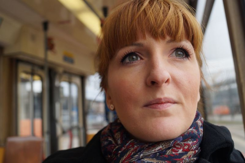 Close-Up Of Thoughtful Woman Looking Away In Tram
