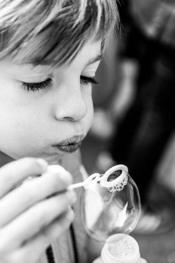 Close-up portrait of a boy holding ice cream