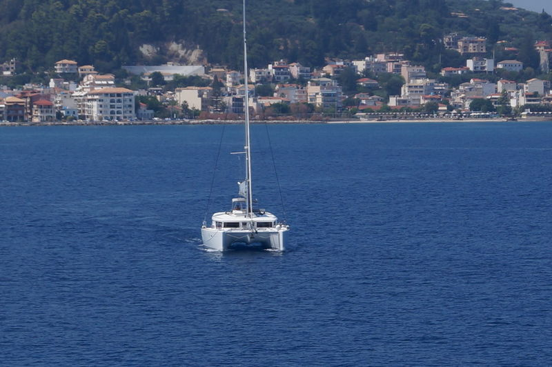 Ship In Sea Against Mountain