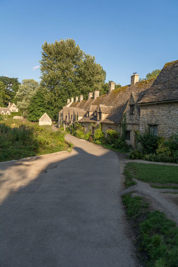 Arlington Row, Cotswolds Ancient Ancient Civilization Architecture Bibury Building Exterior Built Structure Clear Sky Day Grass History Nature No People Outdoors Road Scenics Sky Sunlight The Past The Way Forward Travel Destinations Tree