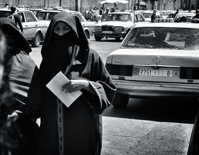 Monochrome Photography Blackandwhite Photography Person Woman Looking At Camera Streetphotography Local Life People Photography Walking Around The City  Real People Blackandwhite Localscene Taxi Burka  Monochrome_life Black And White - Marrakech Morocco Africa Uniqueness Women Around The World Connected By Travel