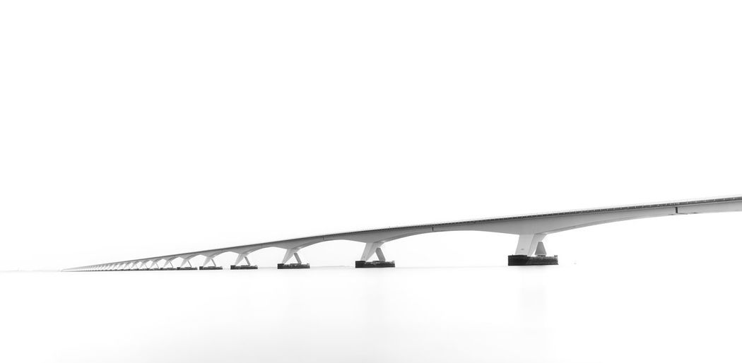 """High key photo of the """"Zeelandbrug"""" in The Netherlands Minimalist Architecture Minimalistic Connection Bridge - Man Made Structure Bridge Architecture Built Structure No People White Background Outdoors Simplicity Transportation High Key High Key Photography Tranquility Zeeland  Zeelandbrug Netherlands Landscape Dutch White Ocean Calm Tranquil Scene"""
