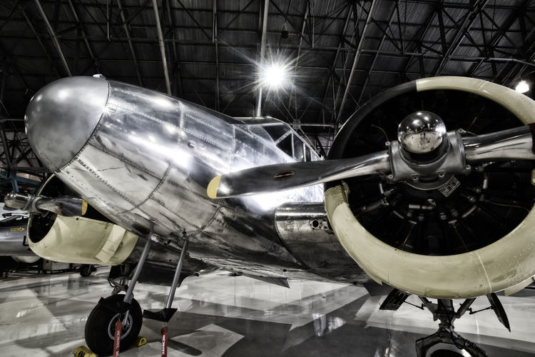 """Jan 2019 - Beechcraft C-45 """"Expeditor"""" """"golden age of aviation"""" Mode Of Transportation Transportation Air Vehicle Airplane Propeller Aerospace Industry Travel No People Close-up Engine Metal Industry Airport Retro Styled Wheel Plane Low Angle View Stationary Indoors  Radial Engine Classic Aircraft Aluminum Skin Tail Dragger Nostalgic"""