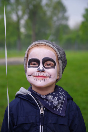 Boys Childhood Close-up Day Elementary Age Face Paint Focus On Foreground Front View Grass Green Color Happiness Headshot Leisure Activity Lifestyles Looking At Camera Nature One Person Outdoors Portrait Real People Smiling Tree