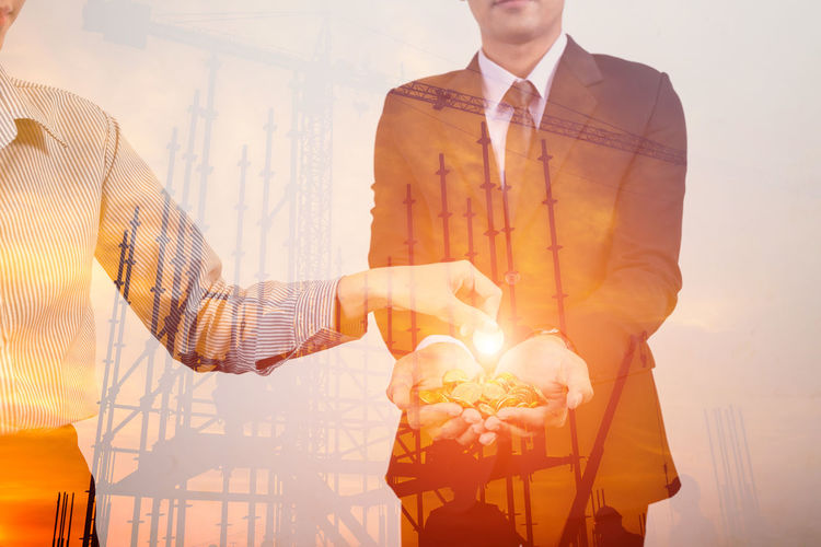 Business investment double exposure silhouette construction site Construction Site Man Adult Burning Business Finance And Industry Fire Flame Glowing Hand Holding Indoors  Leadership Lifestyles Males  Men Mensfashion Menswear Midsection Nature Occupation Orange Color People Real People Standing Well-dressed