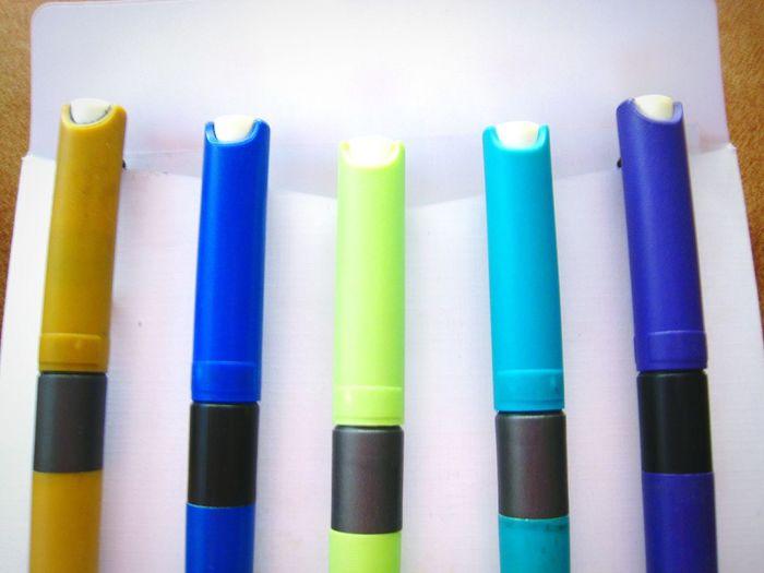 Five different colored felt-tip pens in envelope