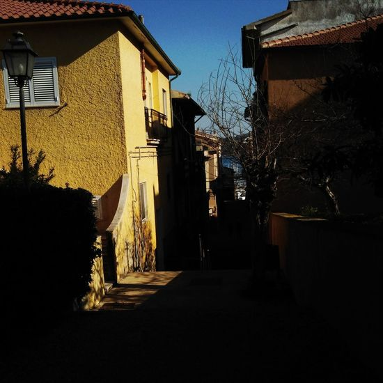 Back street Tranquil Scene Outdoors Outdoor Photography Eye4photography  Instaday Enjoy The Silence Streetphoto_color Yellow Brown Color Alleyway Walking Around Taking Pictures Photographing Shadow Photography Shadow And Light Shadow Architecture Building Exterior Residential Building