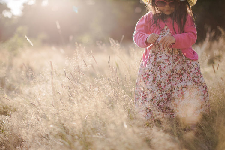 A girl wearing pink playing in the open field wearing pink cloth Field Bokeh Casual Clothing Child Childhood Children Only Day Field Flower Girl Girls Grass Nature One Girl Only One Person Outdoors People Pink Color Portrait Real People Standing Toddler  Tree