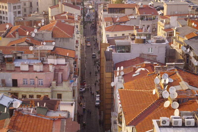 Architecture Birds Eye View Building Building Exterior Built Structure City City Life Community Composition Crowded Day Galata Tower High Angle View House Human Settlement Istanbul Perspective Residential Building Residential District Residential Structure Roof Satalite Dish Street Life Town Turkey
