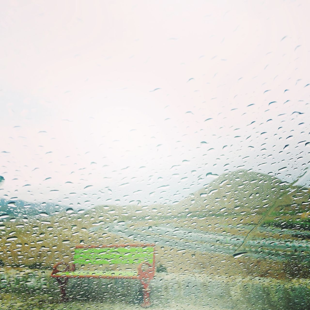 wet, rain, drop, water, window, rainy season, raindrop, glass - material, weather, car, no people, sky, looking through window, car interior, land vehicle, architecture, day, indoors, nature, city, close-up