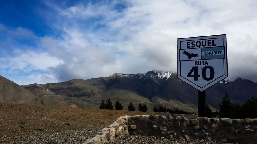 Cluody Sky, near to Esquel, Chubut, Argentina. Beauty In Nature Cloud - Sky Communication Day Esquel, Chubut, Argentina Guidance Horizontal Information Sign Landscape Mountain Nature No People Number Outdoors Road Sign Ruta 40 Scenics Signboard Sky Text