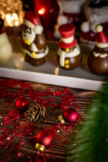 Holiday Celebration Christmas Ornament Christmas Decoration Table Christmas Decoration Indoors  No People Selective Focus Red Still Life Holiday - Event Representation Art And Craft Human Representation Close-up Male Likeness