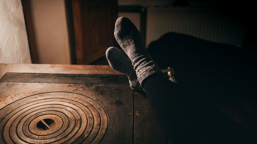 Indoors  One Person Real People Lifestyles Home Interior Oven Winter Cold Temperature Wintertime Socks Staying At Home Winter Time Woman Chilly Cabin