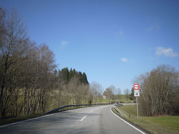 Trafficsign in south Germany Allgäu Guiding Traffic Bare Tree Communication Day Guidance Guide Nature No People Outdoors Road Road Sign Sky Speed Limit Sign The Way Forward Traffic Sign Tranquility Transportation Tree